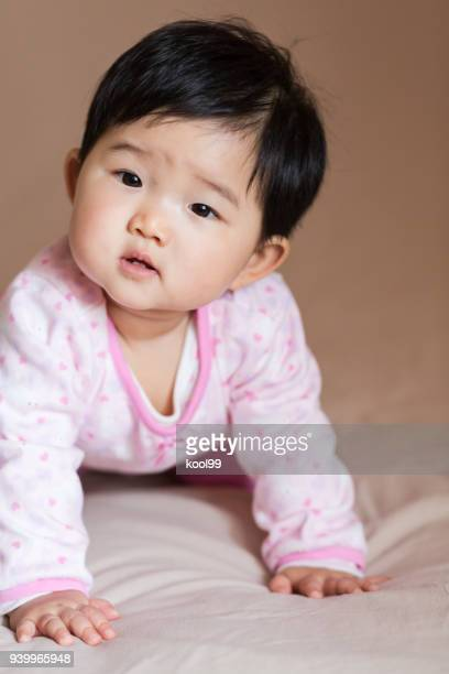 cute baby curious expression - isolated color stock pictures, royalty-free photos & images