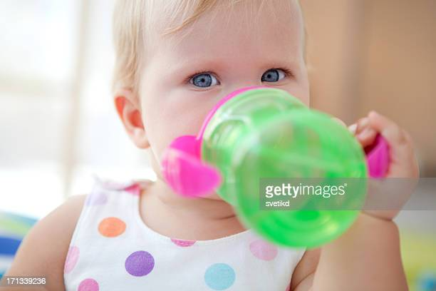 Cute baby drinking water.