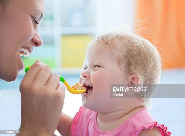 Cute baby eating.