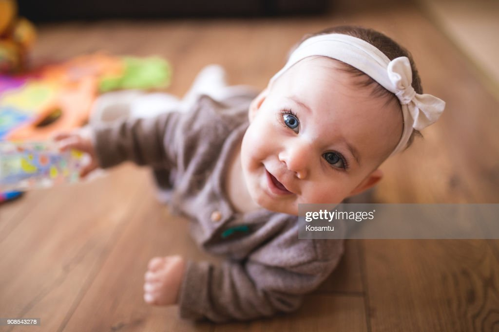 Cute Baby Girl Crawling In Living Room : Stock Photo