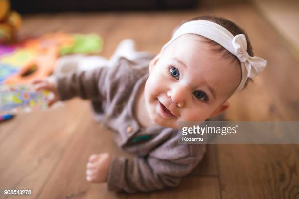 Cute Baby Girl Crawling In Living Room
