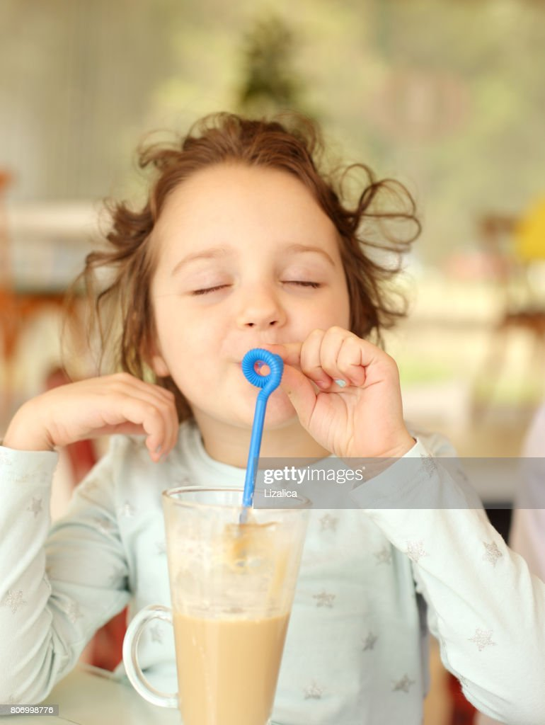 cute baby girl drinking coffee stock photo | getty images