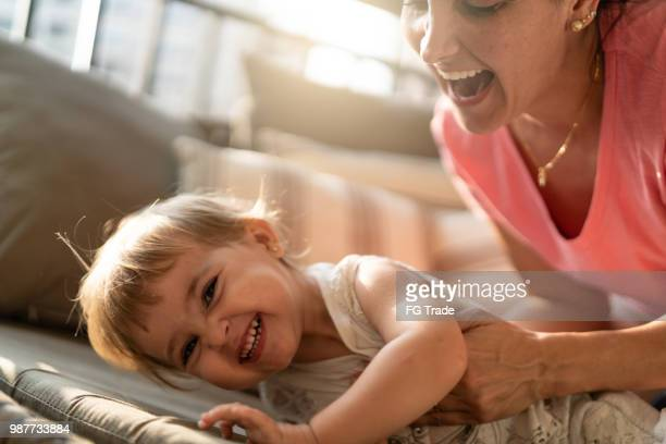 Cute Baby Girl Having Fun with Your Mother at Home