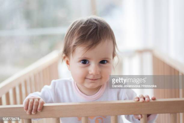 cute baby girl in baby crib
