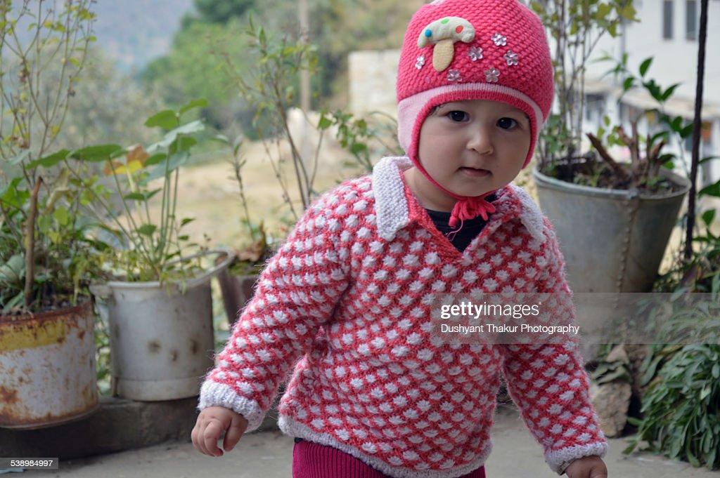Cute baby girl looking at camera