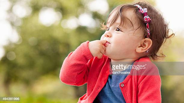 cute baby girl outdoors on the grass - baby girls stock pictures, royalty-free photos & images