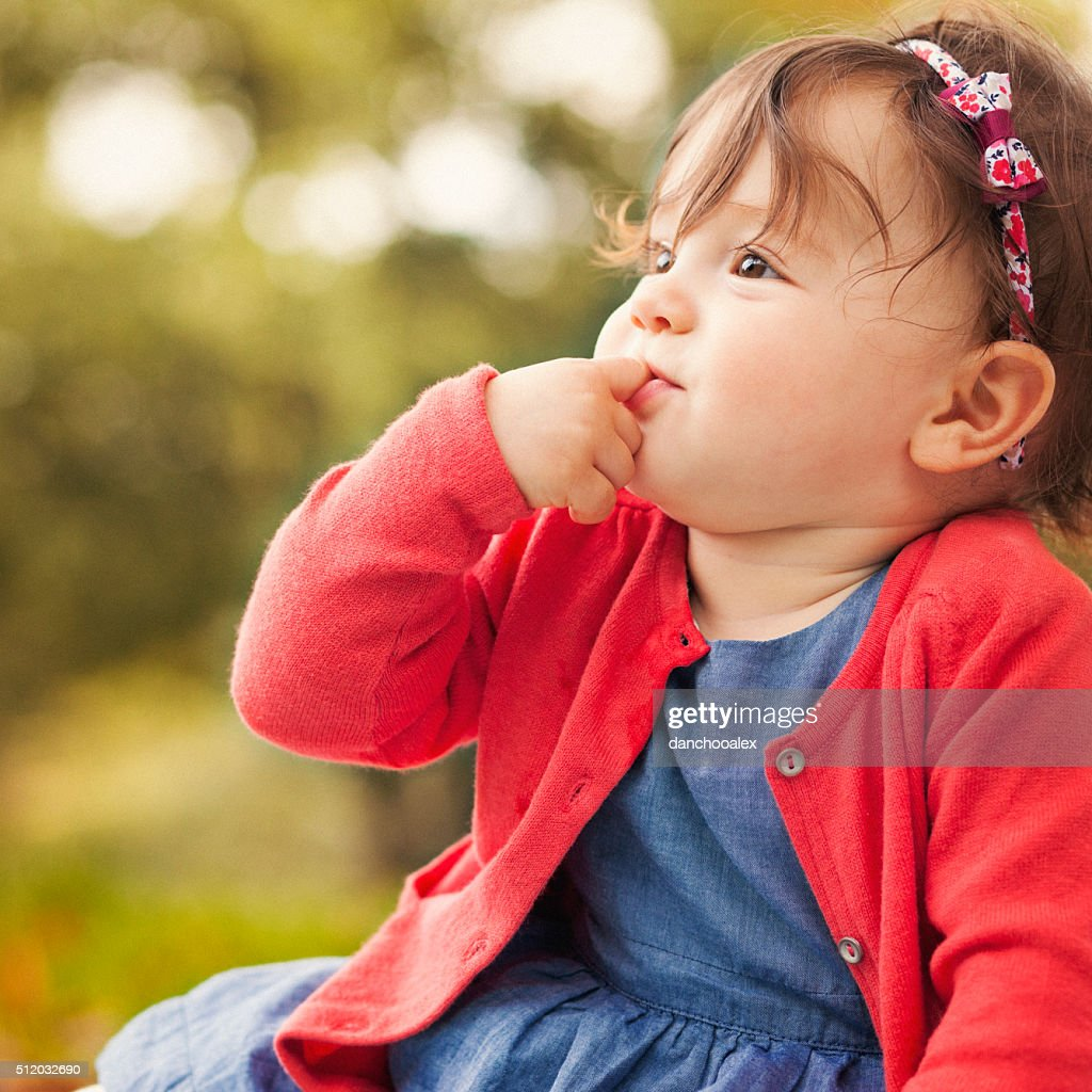 cute baby girl outdoors on the grass stock photo | getty images