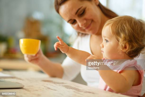 cute baby girl pointing - baby pointing stock photos and pictures