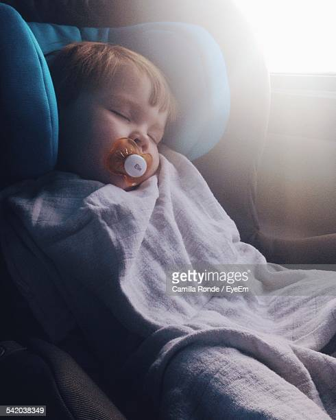 Cute Baby Girl Sleeping In Car