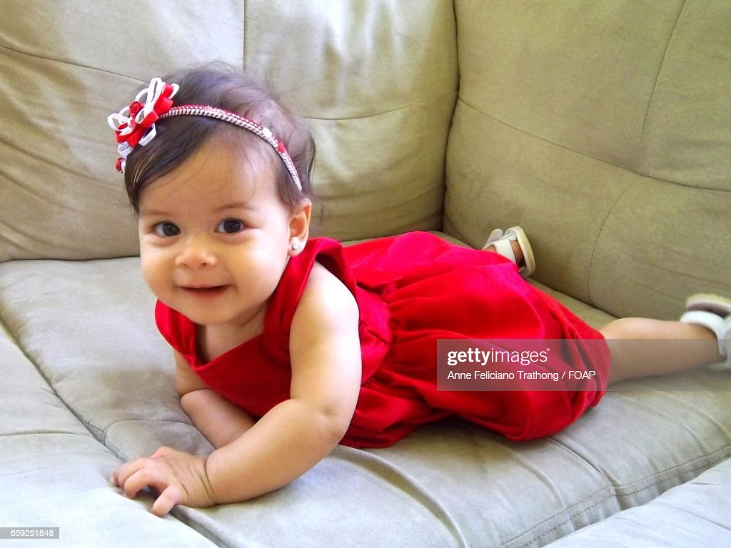 cute baby girl wearing red dress stock photo | getty images