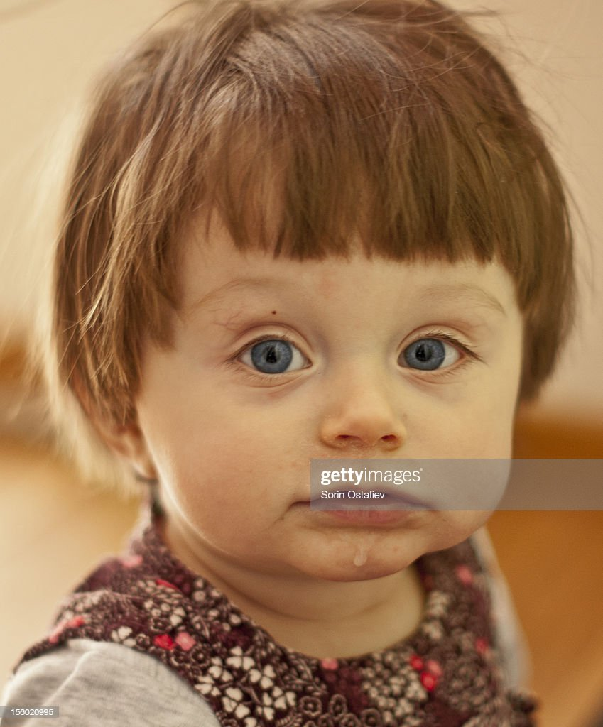 cute baby girl with big blue eyes stock photo | getty images