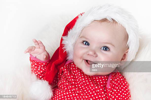 Cute baby girl with santa hat, looking at the camera