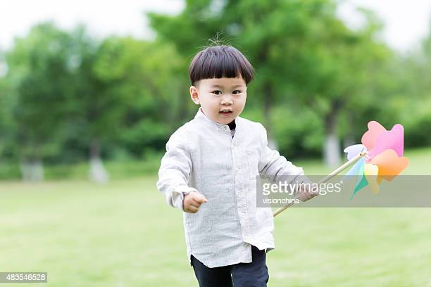 cute baby holding a windmill