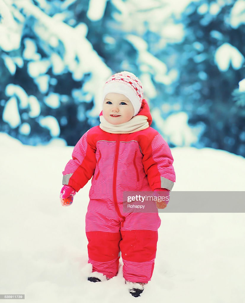 Cute baby in winter snowy day : Stock Photo