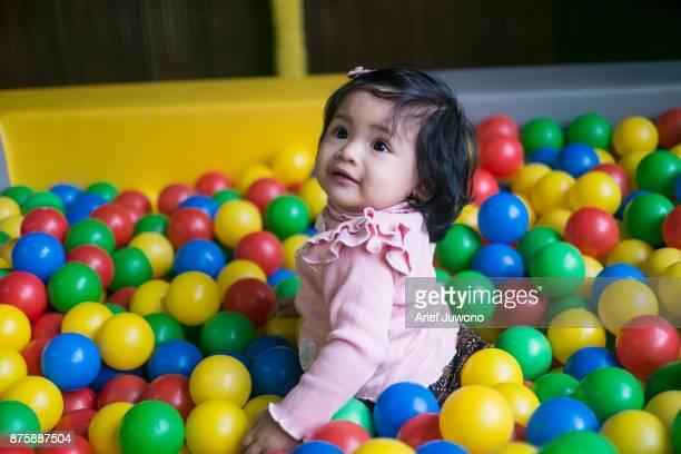 Cute Baby Playing ball at Playground