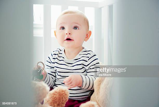 cute baby playing in cot