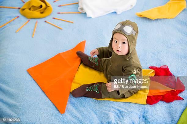 Cute baby sitting on rocket