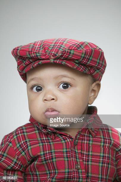 cute baby wearing a flat cap - flat cap stock photos and pictures