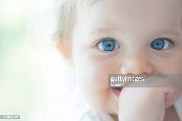 cute baby with big blue eyes - blue eyes stock pictures, royalty-free photos & images