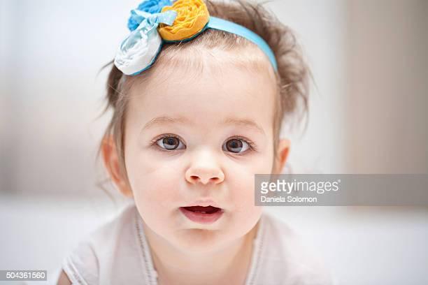 Cute babygirl looking at camera