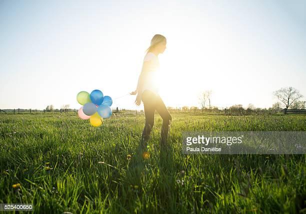 Cute Blond Girl in a Summer Field