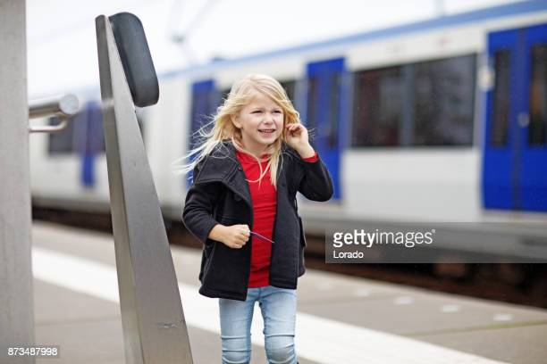 cute blonde female child traveling on public transport - south holland stock pictures, royalty-free photos & images