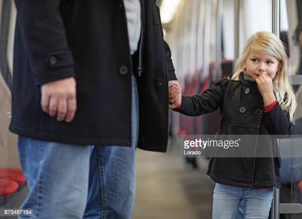 cute blonde girl traveling on public transport with unknown male - stranger stock pictures, royalty-free photos & images