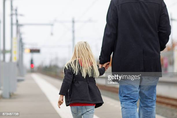 cute blonde girl traveling on public transport with unknown male - kidnapping stock pictures, royalty-free photos & images