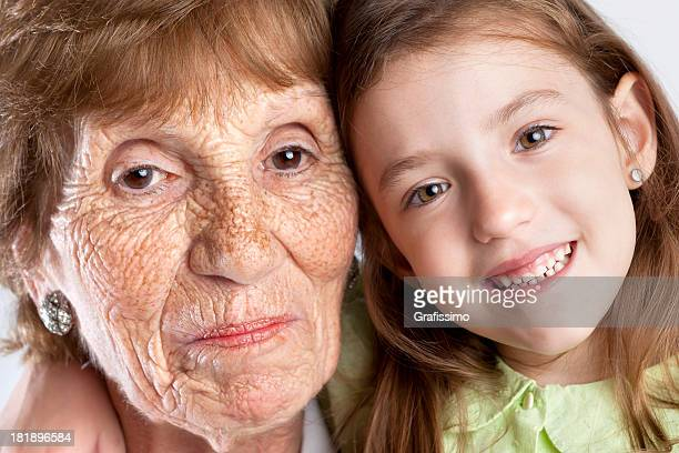 cute blonde little girl with her great grandmother - great granddaughter stock photos and pictures