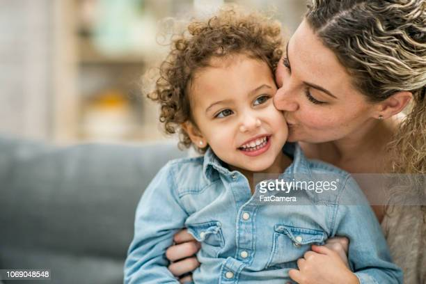 cute boy and his mother - mid adult stock pictures, royalty-free photos & images