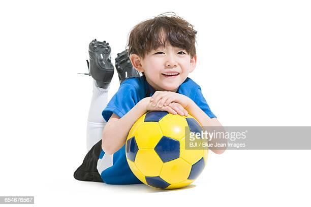 Cute boy and soccer ball