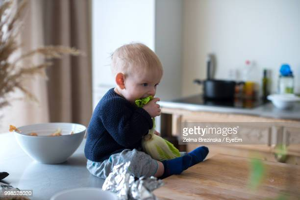Cute Boy Eating Vegetable At Home