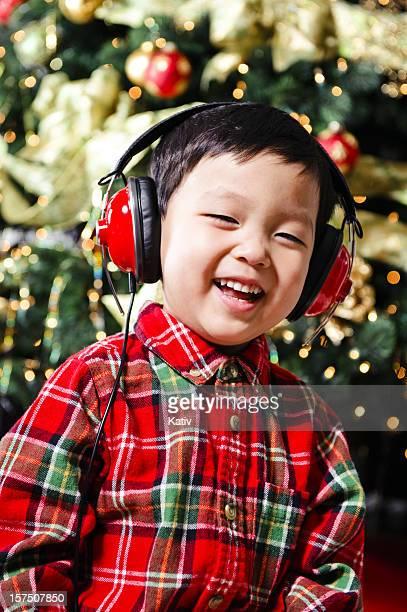 Cute boy listening to Christmas music