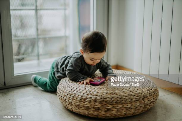 cute boy playing with toy at home - one baby boy only stock pictures, royalty-free photos & images