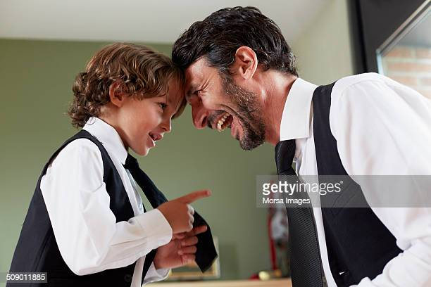 cute boy pointing at happy father - imitation stock pictures, royalty-free photos & images