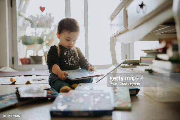 cute boy sitting on floor at home - one baby boy only stock pictures, royalty-free photos & images