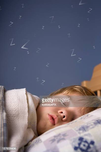 Cute boy sleeping in bed