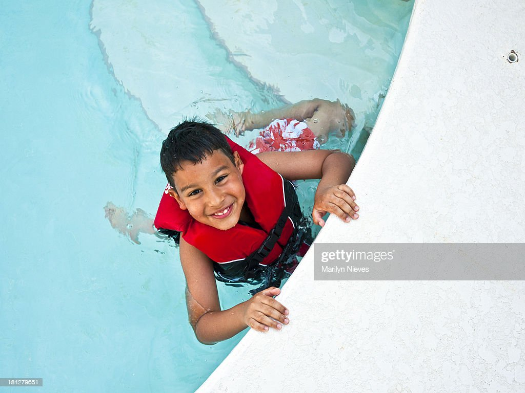 cute boy swimming : Stock Photo