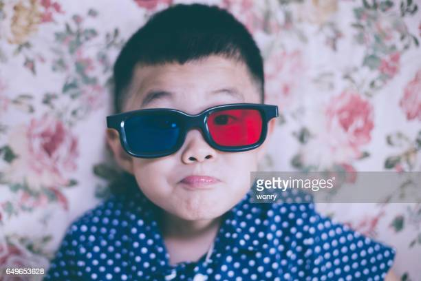 Cute boy watching with 3D glasses