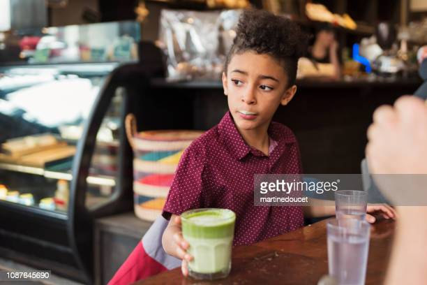 """söt pojke med dryck mustasch i restaurangen under vintern. - """"martine doucet"""" or martinedoucet bildbanksfoton och bilder"""