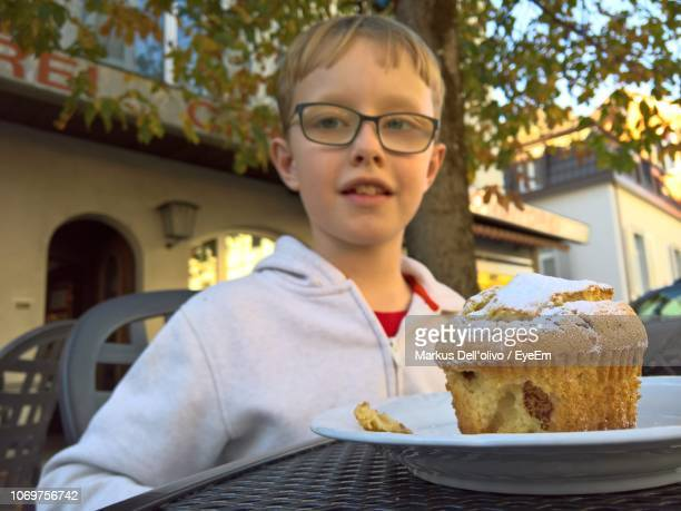 Cute Boy With Dessert On Table