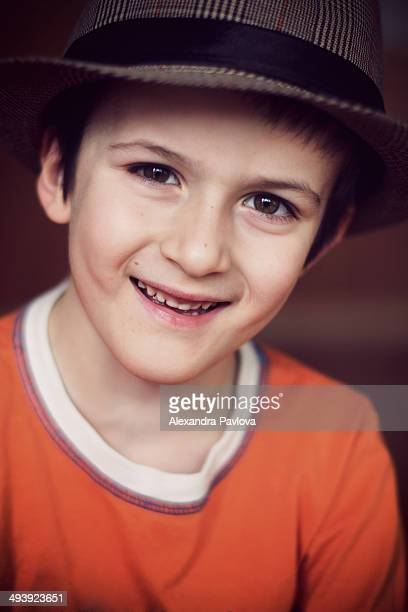 cute boy with hat smiling happily - alexandra pavlova stock pictures, royalty-free photos & images
