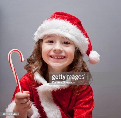 Cute Boy With Long Hair And Christmas Lollipop Stock
