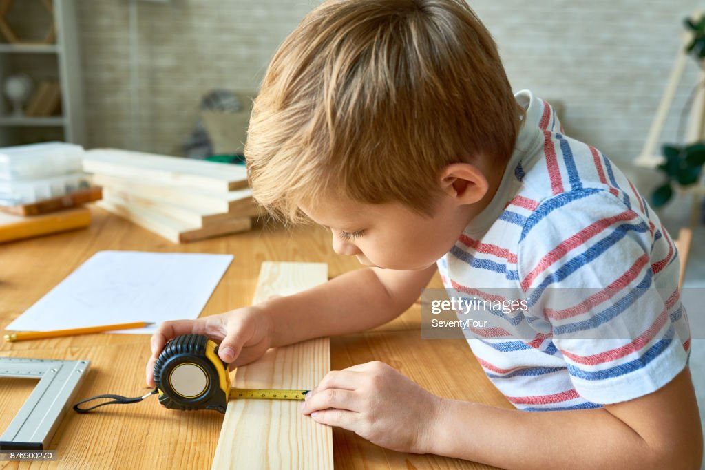 Cute Boy Working with Wood : Stock Photo