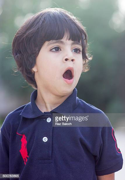 cute boy yawning - cute pakistani boys stock photos and pictures