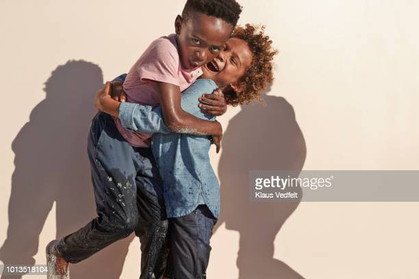 cute boys playing and posing in front of camera - innocence stock pictures, royalty-free photos & images