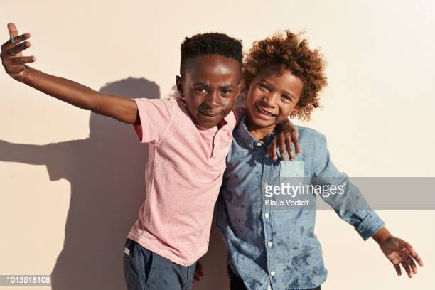 cute boys playing and posing in front of camera - children only stock pictures, royalty-free photos & images