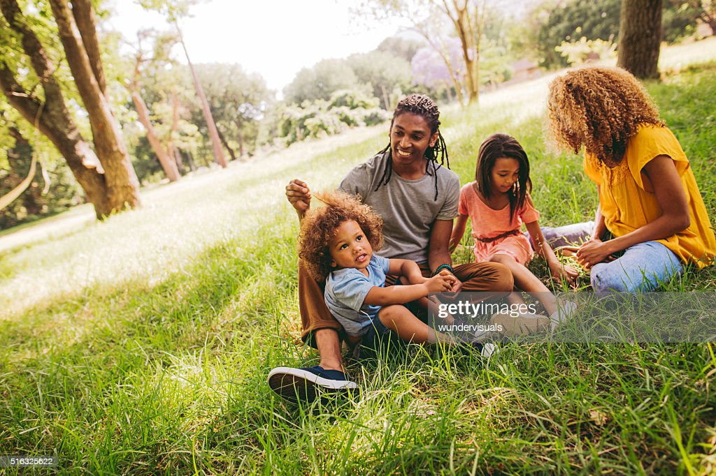 Cute brother and sister spends time with their parents. : Stock Photo