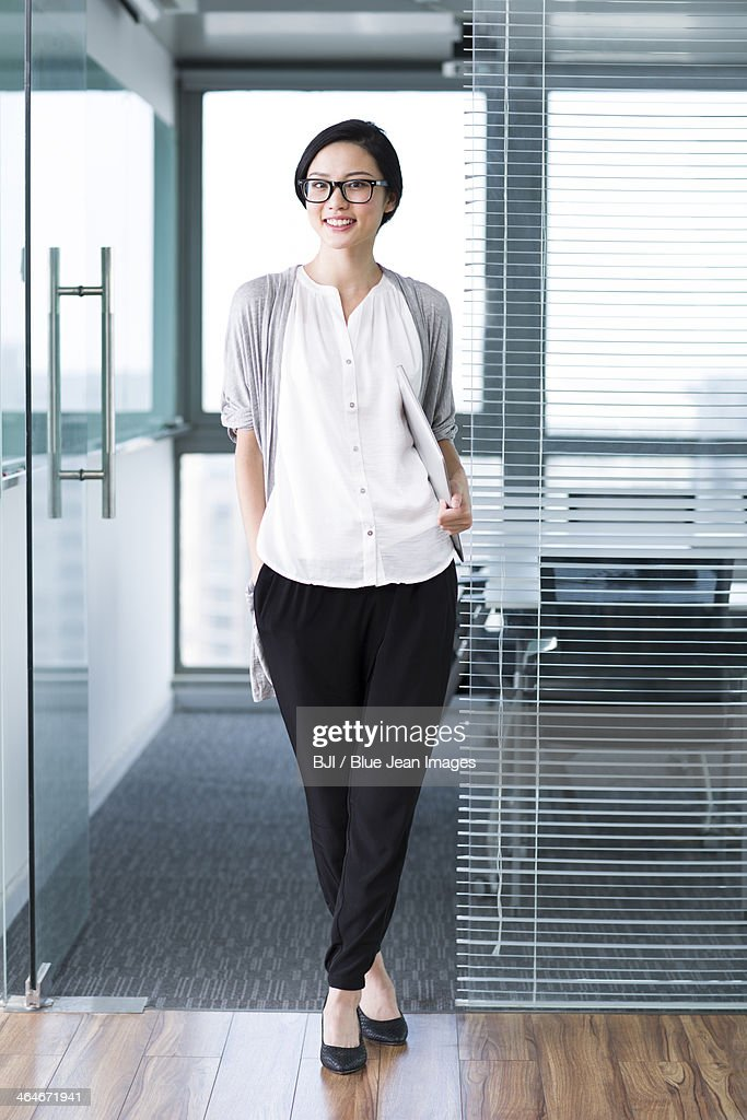 Cute businesswoman with laptop in the office : Stock Photo