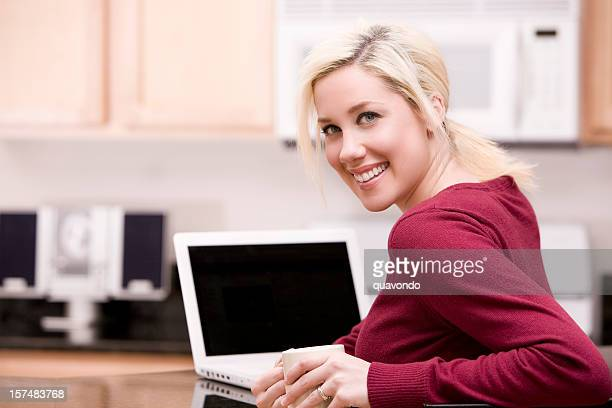 cute caucasian young woman using laptop in kitchen, copy space - personal compact disc player stock pictures, royalty-free photos & images